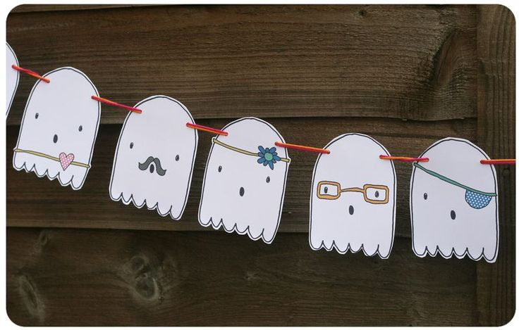Ghost garland -- accessorized with bows, glasses, and 'staches :)