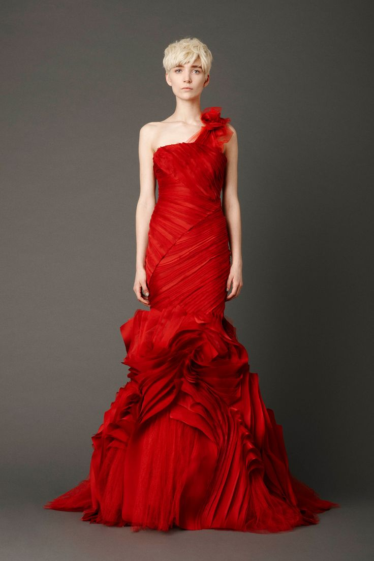 Scarlett mermaid gown with tiered, micro–bias bodice and inverted flange skirt with abstract floral shoulder corsage detail