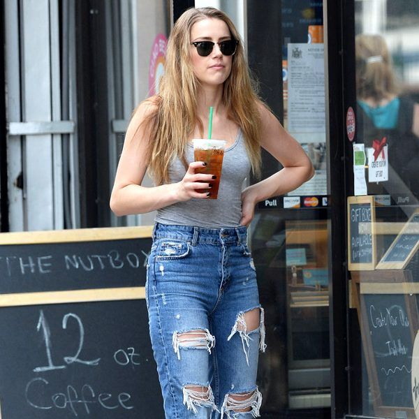 Amber Heard channeled her inner vintage rocker by sporting torn denim jeans, badass black booties and Clubmaster-inspired shades!