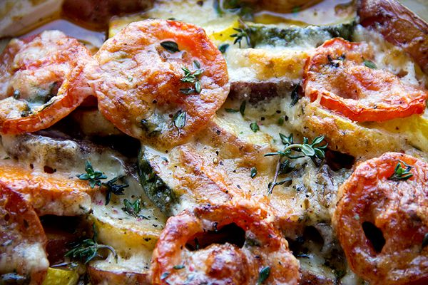 Four-Potato Gratin with Thyme, Caramelized Onion, Tomato and Squash