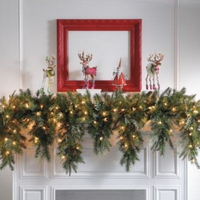 Cascading christmas garland mantels pinterest for Christmas mantel decorations garland
