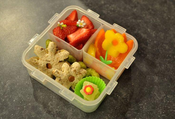 Flower garden lunch. Strawberries, orange pepper tulip (hard to see ...
