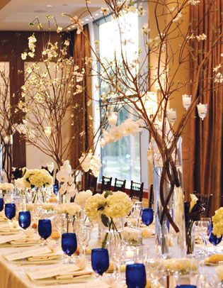 Centerpieces: branches with hanging candles. Love the simplicity yet elegance