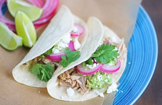 Shredded pork tacos with avocado, quick pickled onions and queso fres ...