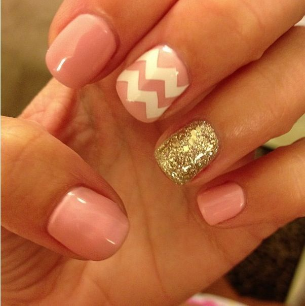 pink nail polish with gold and white chevron design