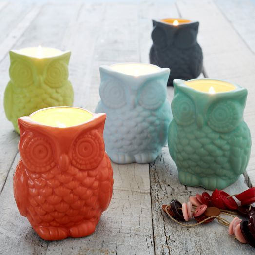 In a range of colorful holders, these Filled Owl Candles add a woodsy scent to any room in your home.