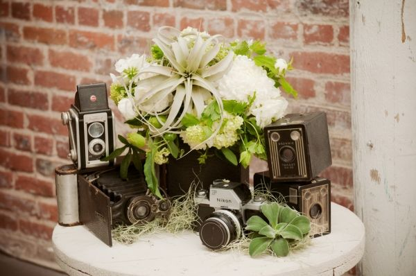 OH !!!!!!!! Decorating/theme is cameras/photography!! Wow-- Breakthrough in future wedding ideas