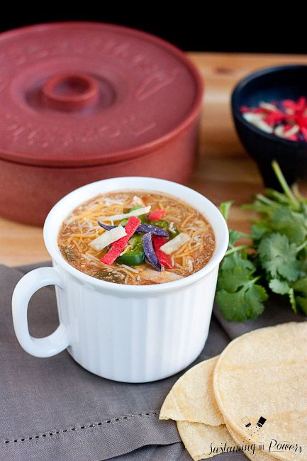 Slow Cooker Chicken Tortilla Soup -Crocktober Week 4.  This comforting soup has all your favorite Tex-Mex flavors from chicken enchiladas with tons of soup topping options. Throw this in your crockpot, walk away, and come back to a family favorite soup night. #glutenfree and can be #vegetarian or #vegan The Ultimate Pinterest Party 23