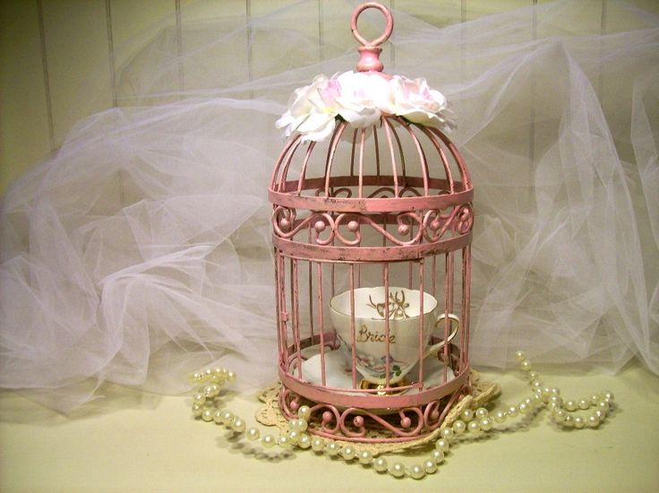 Vintage bird cage shabby chic with bride cup and saucer