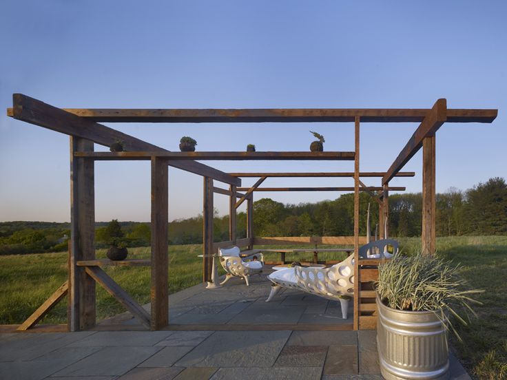 MD+B provided design, carpentry , and lumber for an outdoor pavilion showcasing concrete furniture  by sculptor Robert Cannon. The structure incorporates material from a half dozen area sites. The patio was artfully incorporated by Buena Vista Landscaping and Atlock Farms contributed a variety of plantings.