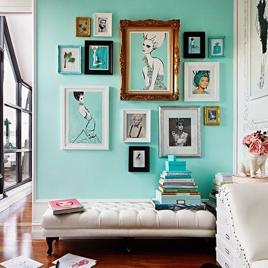 Fashionable colorful gallery wall of Vogue covers and drawings of women. Cool