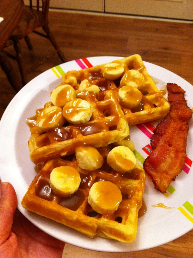 Waffles with carmel sauce instead of syrup and bananas! And a slice of ...