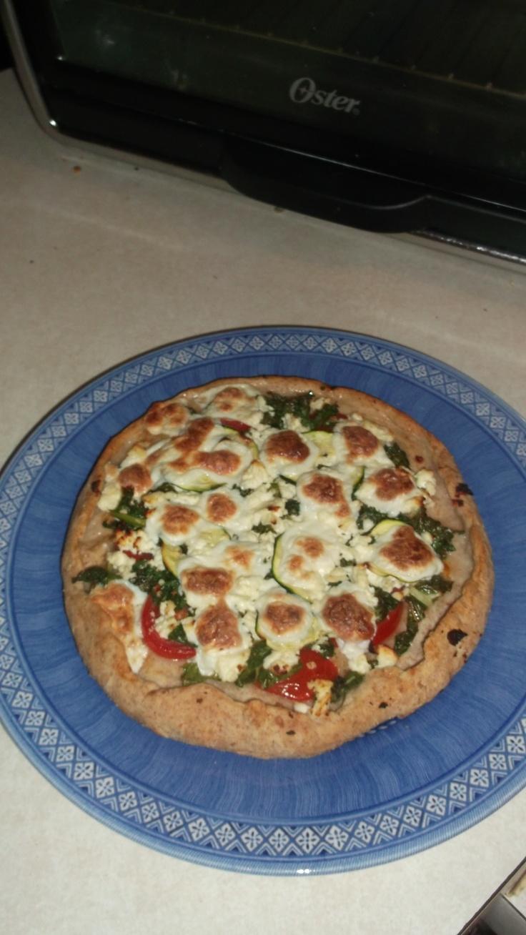 Veggie Greekish pizza with tomatoes, kale, zucchini, oregano, garlic ...