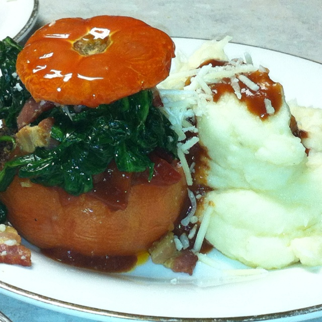 Spinach stuffed tomato with whole roasted garlic mashed potatoes with ...