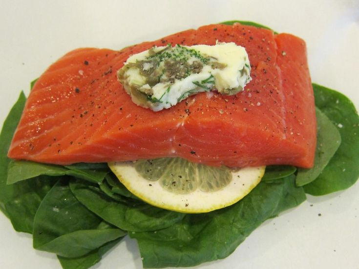 Salmon, spinach, and potatoes baked in parchment paper with caper ...