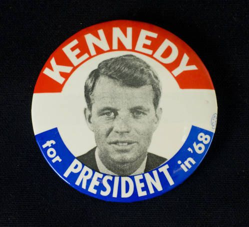Campaign pin for Robert Kennedy's 1968 presidential bid. Kennedy spoke at San Fernando Valley State College (SFVSC, now CSUN) on March 25, 1968. SFVSC was a campaign stop for a wide variety of local, state, and national politicians in 1968. CSUN University Digital Archives.