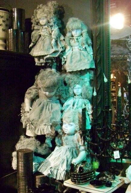 classy halloween decor - spray paint thrift store dollies white and lt. grey to haunt your halls on Halloween
