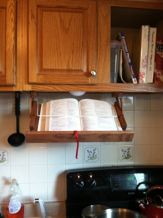... idea....storable recipe book holder attached under cabinet + light
