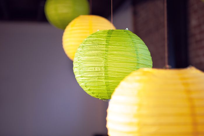 theme design summer yellow and lime green feel of nature. 'low-budget' idea decorations yellow and green lanterns flower pots grass plants sweets summery cupcakes color scheme cake pops ribbon designs delicious lemon flavored trifles de verrines freshness lemonade green striped straws salar planners salar event planning