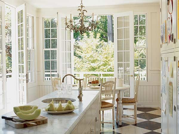 What's not to love about this white kitchen with French doors and a painted checkerboard floor? myhomeideas.com