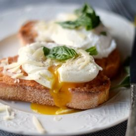 Fresh, warm toast rubbed with tomato and garlic. Topped with a poached ...