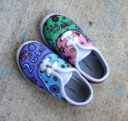 Hand drawn designs in Sharpie on kids shoes.