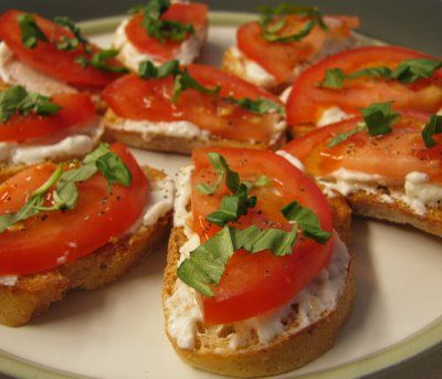 Tomato & basil crostini with feta and roasted garlic cheese spread
