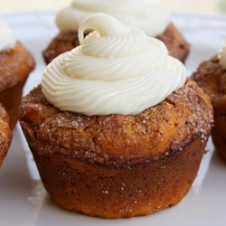 Moist Pumpkin Spice Muffins with cream cheese frosting.