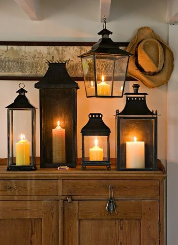 "adore this idea of all the ""lantern"" candles together and all lit at once. so pretty."