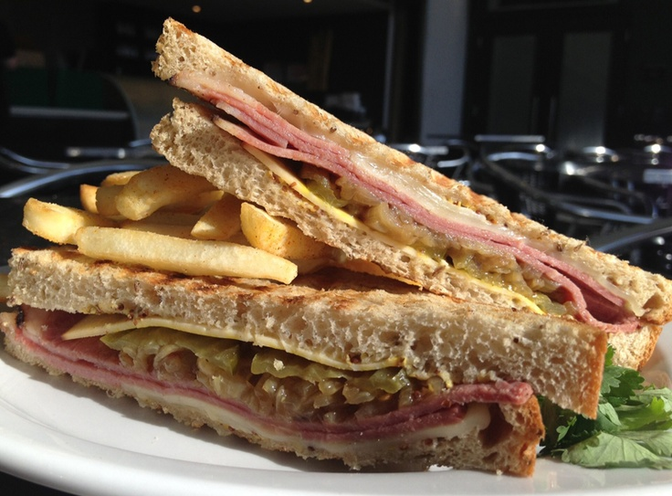 serving up a delicious New York pastrami sandwich: rye bread, pastrami ...