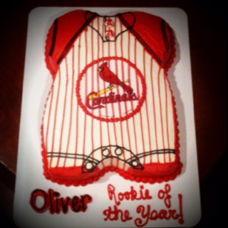 St Louis cardinals onesie baby shower cake.