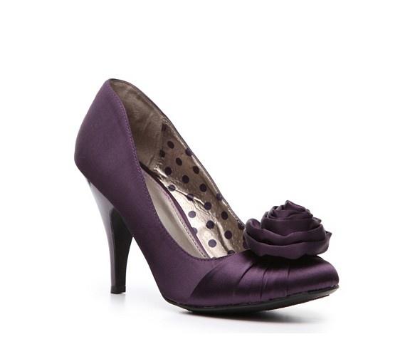 purple shoes under the white dress