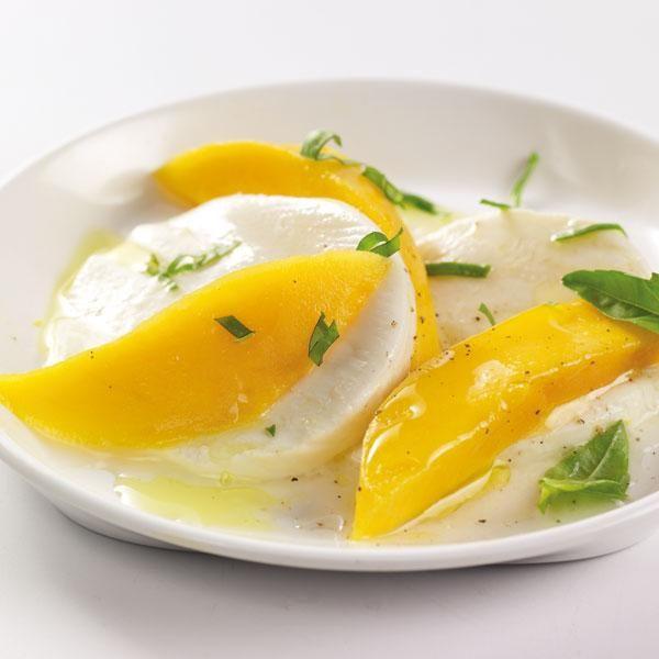 Mango Caprese Salad--interesting, and sounds refreshing. Love mangoes ...