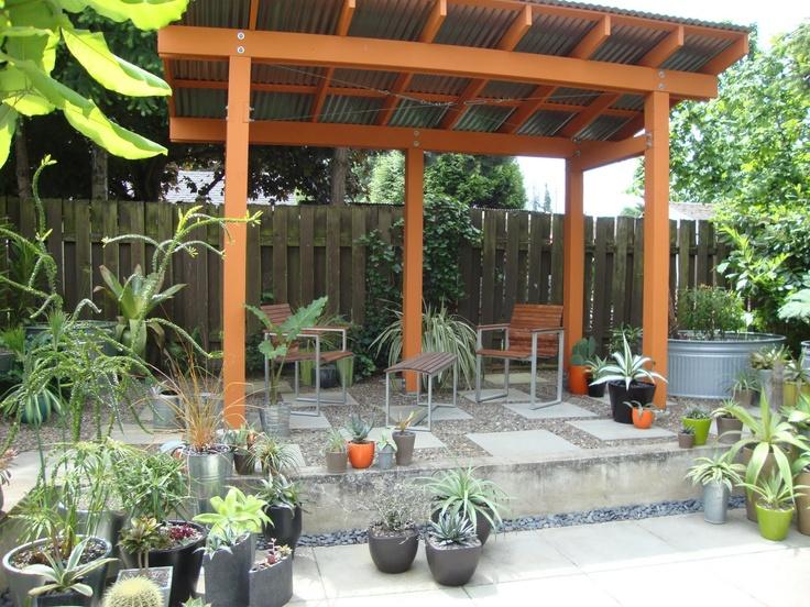 great backyard shade structure i like the pebble choice