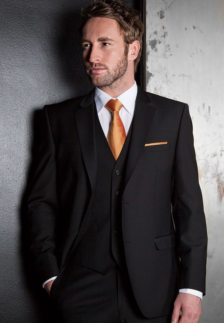 black three piece tailored fit suit with burnt orange tie