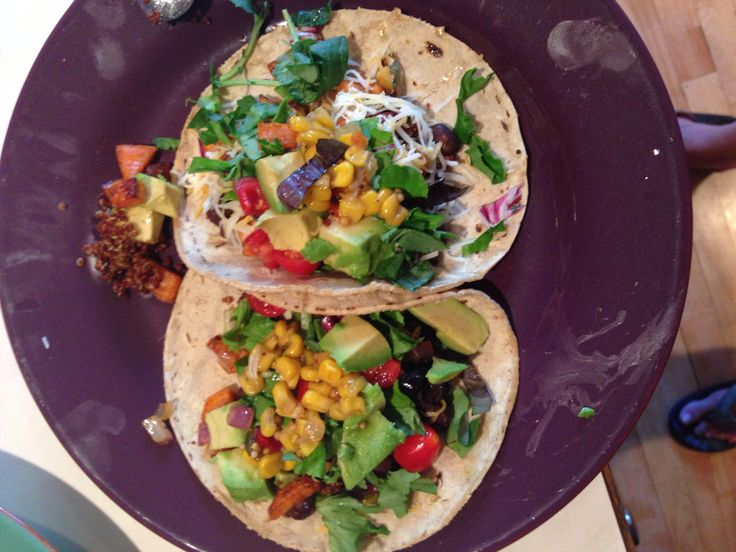 Sweet potato, quinoa, kale, black bean, corn and avocado tacos! Yummm