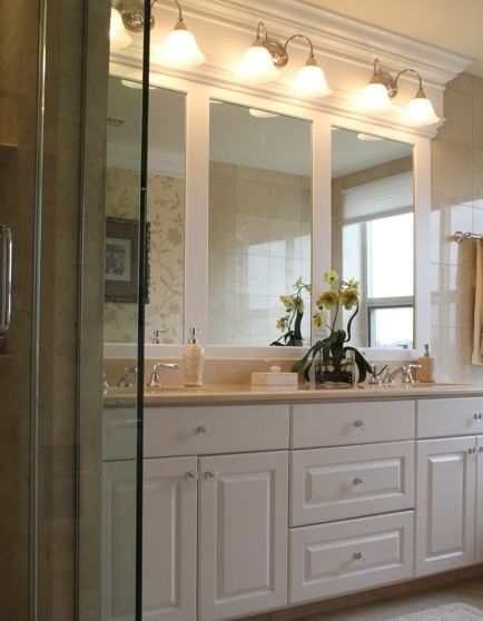 millwork framing bathroom mirror and lights the woodwork to the