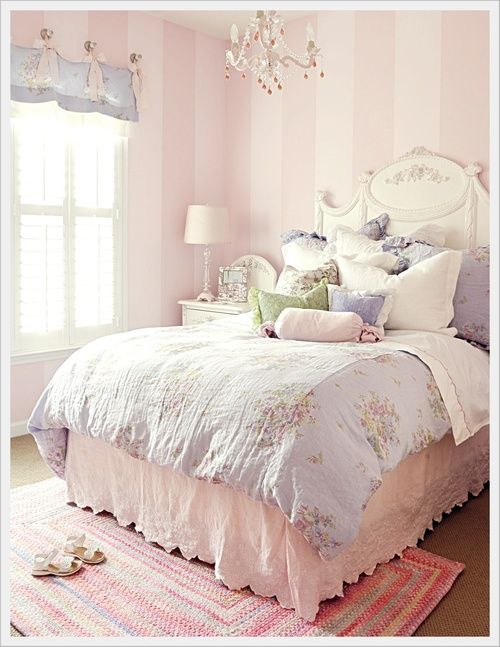 Another amazing bedroom idea. Love the light pink striped walls, the chandelier and the area rug together!