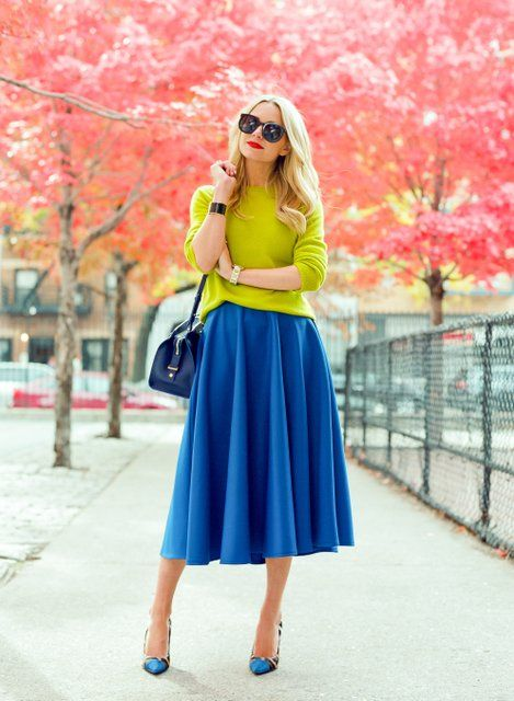 Blue maxi with yellow sweater and handbag