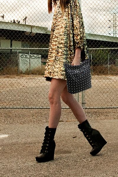 A little bit glamorous. Love the wedge boots and studded bag.