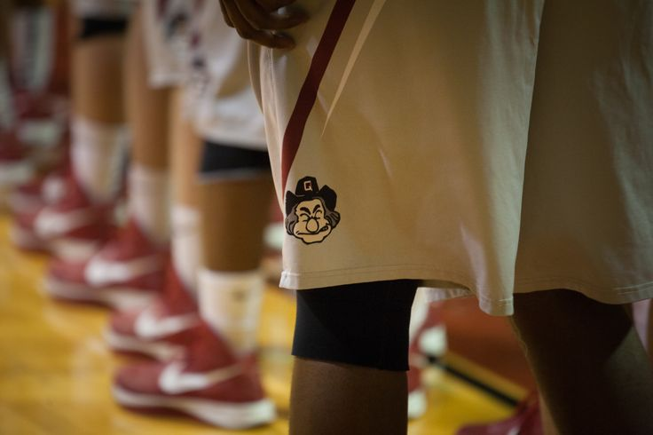 Guilford College Men's Basketball players lining up before their game.