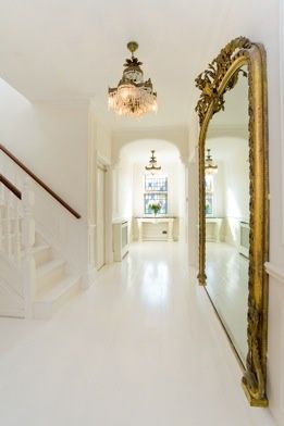 oversized gold mirror in all white house glamorous mirror gold detials.