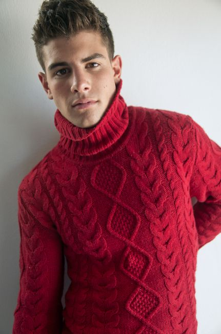 Frankie C, model, in red cable knit turtleneck sweater