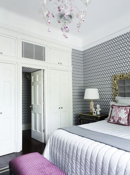 contemporary bedroom by Greg Natale; floor to ceiling storage symmetrically placed around entry door. Graphic wallpaper.