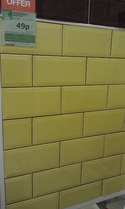 Grey or dark grout with the yellow tile in main bath
