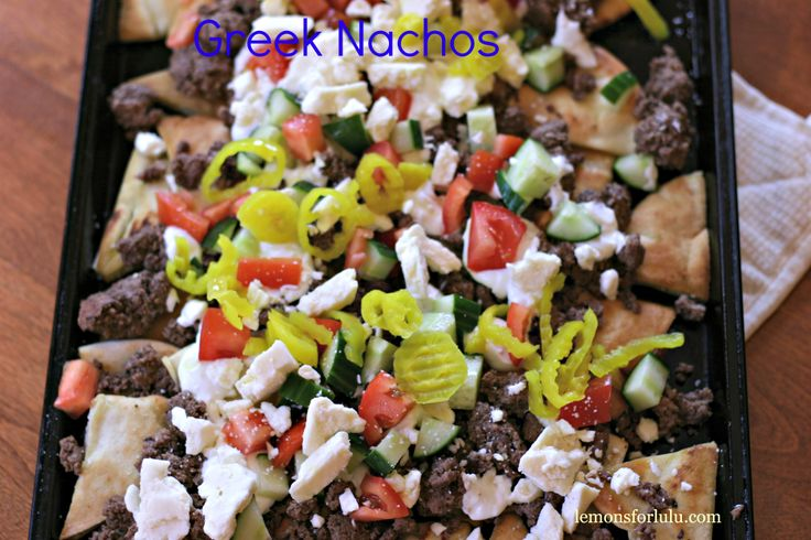 Greek Nachos, pita bread, seasoned ground lamb and tons of toppings ...