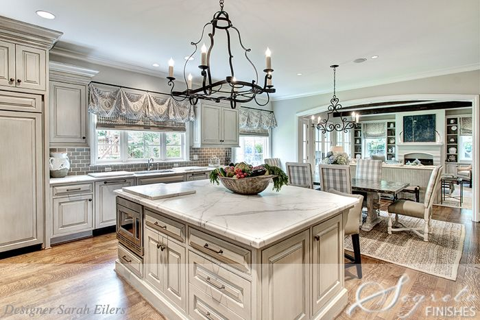 love the flow (cabinets finishes by Segreto); BM Grant Beige (half
