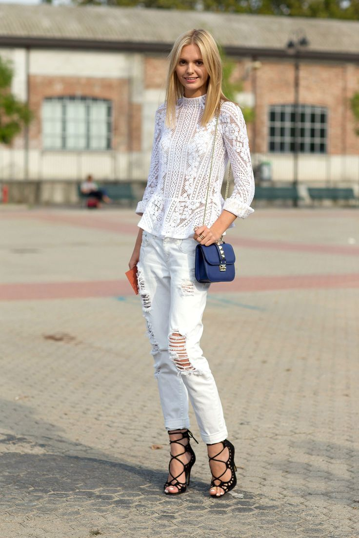 9 Ways to Wear White Denim - Blogger Jessica Maystein's playful pairing of ripped skinny jeans with a sophisticated lace blouse makes for one seriously stylish look.