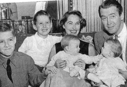 Jimmy Stewart and his wife Gloria Hatrick McLean. Stewart adopted her two sons, Michael and Ronald, and the two had  twin daughters, Judy and Kelly Stewart.All are pictured here.