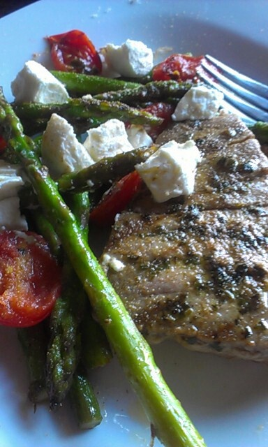 ... side grilled asparagus and cherry tomatoes -topped with goat cheese